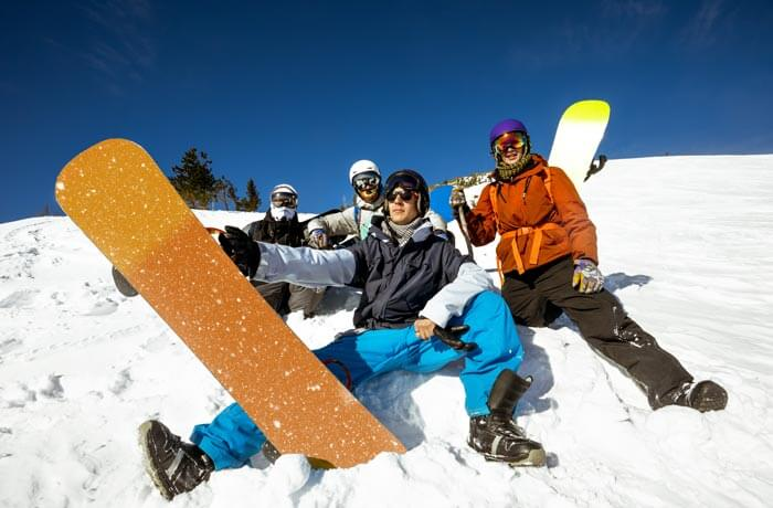 Queenstown stag party on ski slopes with snowboards.